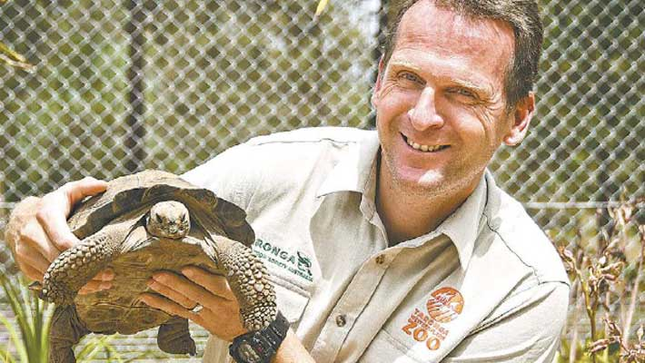 Taronga Western Plains Zoo Precinct Manager Bruce Murdock with a Tortoise. Image: Wendy Merrick for Dubbo Photo News