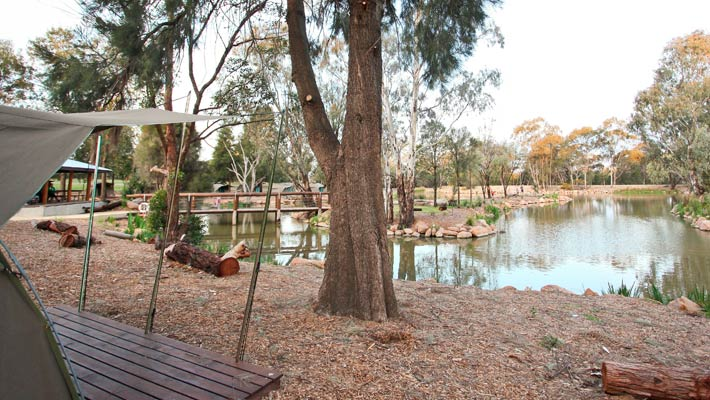 The campsite is arranged around a central Billabong