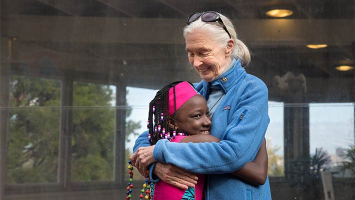 Dr Jane Goodall with a member of the 100% Hope Choir from Uganda. Photo: Rick Stevens